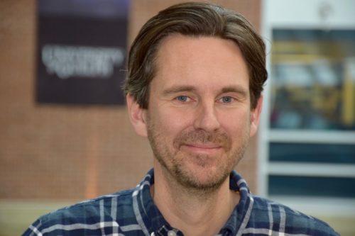 Smiling portrait of biology professor Ryan Norris