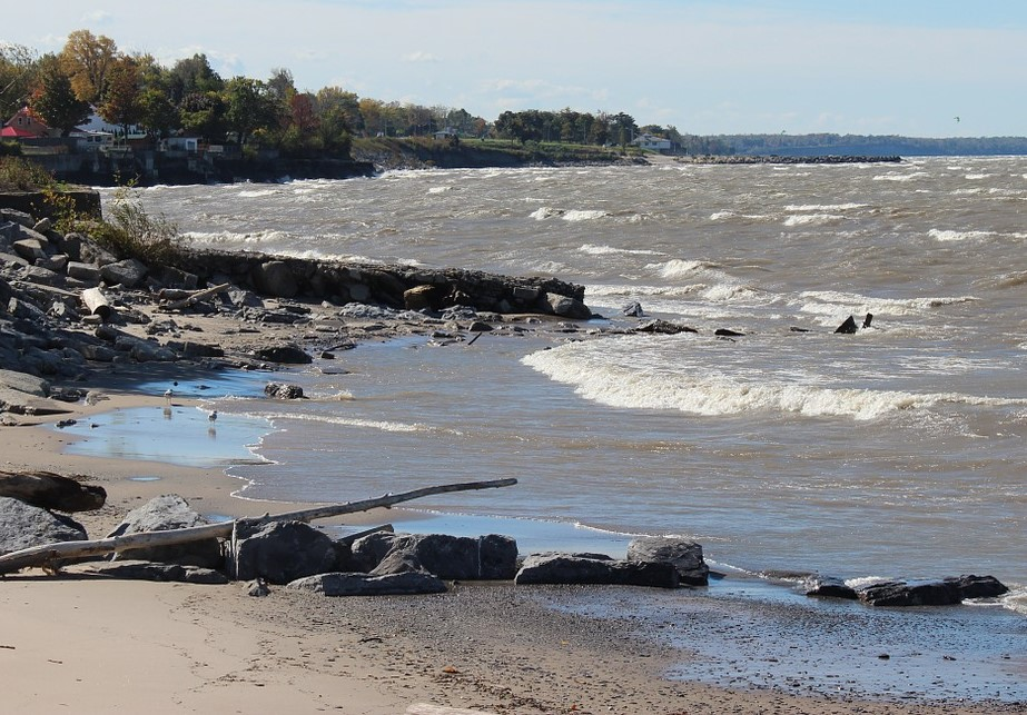 A Lake Erie beach with cloudy water and white crests