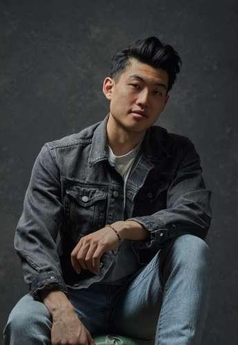 Young Asian man in denim shirt