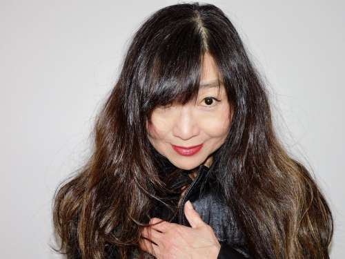 Asian woman with long dark hair