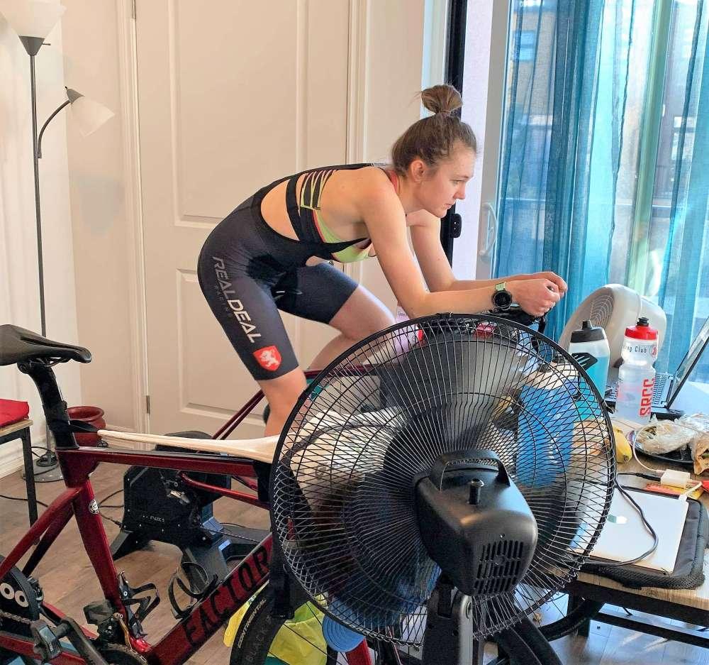 Woman on a stationary racing bike